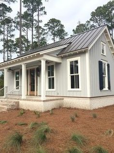 metal roof and white farmhouse | 7,652 batten and board siding Exterior Design Photos: