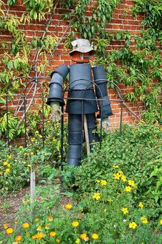 What to do with all those black pots - make a scarecrow!