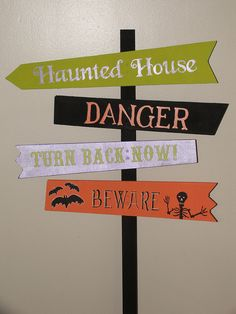 Halloween sign: Haunted House, Danger, Turn Back Now, Beware by Murals By Massucci, via Flickr