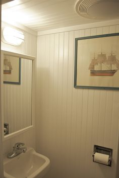 Floor to Ceiling Beadboard | small but tidy little bathroom where everything including the door,