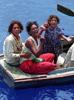 "DESPERATION : In this iconic Miami Herald photo taken Aug. 24, 1994, these two women and a child plead for help as they drift some 45 miles off the north coast of Cuba. They were among the ""balseros"" fleeing communist Cuba."