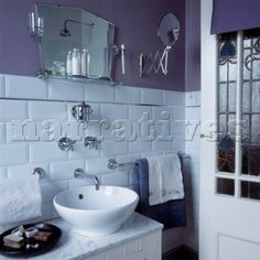 Bathroom with white vintage style tiles purple painted walls