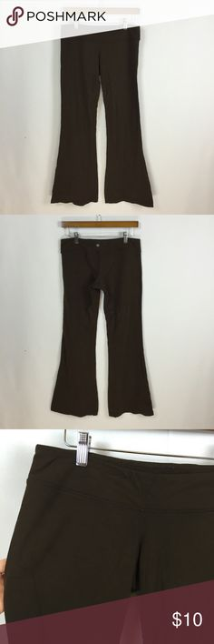 """💥$10 SALE!💥Lululemon brown flared leg yoga pants Can't find a size tag- 28"""" waist. Dark brown, Flared leg. Pilling throughout and what looks like a water mark on the front , see photos. lululemon athletica Pants Leggings"""
