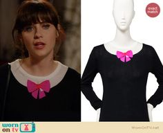 Jess s black sweater with pink bow and purple skirt on new girl