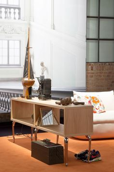 A combination of practical, light wooden compartments and of classically sculptured legs, the Bassotti sideboards by Marcel Wanders embody the perfect storage solution for any home or office environment.
