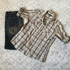Vans plaid Flannel Vans flannel, (Blues, Browns like a mint green) 100% cotton button down, two front pockets, very cute with some dark wash jeans and boots! sleeves are rolled up and buttoned up and you can undo the button for longer sleeves (refer to 3rd photo I unrolled one sleeve).  Total of 8 buttons and doesn't come with any spares. No rips, no tears, no holes, no other flaws noted, in excellent condition! Vans Tops Button Down Shirts