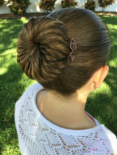 Beautiful pinwheel sock bun adorned with copper rose u-pins.