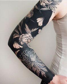 trendy blackwork tattoo on arm