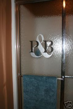 Monogram on shower! CUTE. I can do this because we have the glass rolly doors on our shower