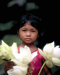 Little girl selling flowers, Angkor Wat, Cambodia