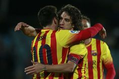 Barcelona's Lionel Messi from Argentina, left, celebrates his goal with Carles Puyol, right, during a Spanish Copa del Rey match between...