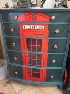 """One of the dressers that I made for the boys' """"Union Jack"""" bedroom. Painted ASCP Aubusson Blue with dark wax and decoupaged a telephone boot onto the drawer fronts."""