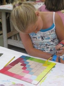 Great idea when teaching color wheel.  Site also has other pictures of great art projects. - love the look of concentration!