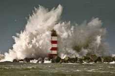 Stock Photo - The Netherlands, IJmuiden, Storm. Waves crash against lighthouse or beacon Cool Pictures, Cool Photos, Surf, Beacon Of Hope, Crashing Waves, Belle Photo, Mother Nature, Lighthouse, Seaside