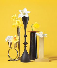 Use candlesticks as bud vases ~ cut stems short and add water to keep blooms upright for a night. (Alas, beauty is fleeting.) Larger candleholders, like hurricane lamps, can hold a small flower arrangement. Mix & match candleholders and even have some with flowers & some with candles/tealights/votives. You can also use votive holders for small dessert cups (try chocolate mousse!)