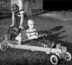 Ours didn't have a motor. We made it with the wheels from our old red wagon and mom's old wooden ironing board. Dad rigged the steering wheel. We pulled it behind our bikes.