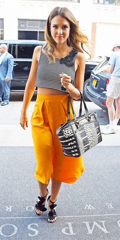 Jessica Alba looks absolutely fabulous in this bright orange high-waisted skirt. // #Fashion