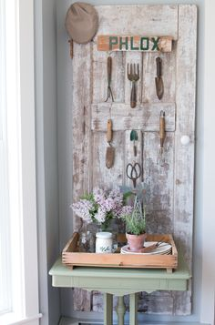 I am at it again. I can't help but work on projects with vintage doors. This door used to house a plate wall, but I have been finding myself drawn to vintage garden tools lately and before I knew it, I had a collection!