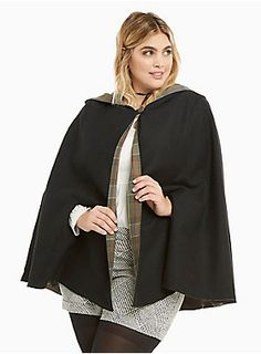 """This reversible cape is fit for an adventurer like Claire. The weighty black knit sports a Fraser tartan that you can reverse depending on how Scottish you want to get. Arm slits provide functionality, a button neck closure keeps the look together, a hood is effortlessly comfy.<div><br></div><div><b>Model is 5'10"""", size 1<br></b><div><ul><li style=""""LIST-STYLE-POSITION: outside !important; LIST-STYLE-TYPE: disc !important"""">Size 1 measures 34"""" from shoulder</li><li style=""""LIST-STYL..."""
