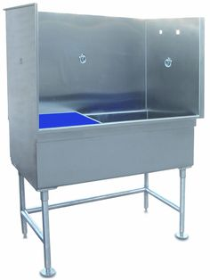Beautiful stainless steel dog bath. Hand crafted & built in the USA with multiple restraint rings, an elevated, removable grate for bathing small breeds. Ships fully assembled. Perfect for professional the professional groomer. Our grooming tubs make the best back saving devices
