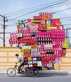 French photographer Alain Delorme's Totems series is a vivid and colorful documentary of bicycle-based object transportation in China We Are The World, People Of The World, Totems, Shanghai, Le Totem, Tinker Tailor Soldier Spy, Moving Day, In China, French Photographers