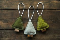Woodland Tree Ornaments - Primitive Christmas Holiday - Evergreen Woodland Pine Entirely hand-cut and sewn using buttery soft 100% wool fabric in patterned shades of green and brown  - Gently stuffed with Poly-Fil for shape  - Loop of cream cotton cord firmly attached for easy hanging  - Each heart measures approximately 3 inches wide by 4 inches tall  - Image 5 shows the back of each ornament