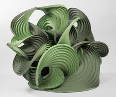 These beautiful curved-crease sculptures are by father-son duo Martin Demaine and Erik Demaine. The sculptures are self-folding origami—creases in the paper cause the sculptures to fold into complex forms.