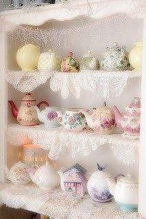 Teapots lined up on a shelf!