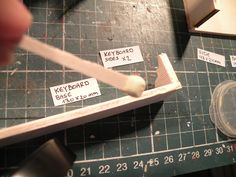 Miniature Piano workshop. Step no.9  Apply some glue on the back side of the keyboard.