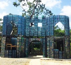 This Bottle House is part of an Eco-Village in founded by Robert Bezeau in remote Panama. An armature is built and filled with empty bottles. They are not weight bearing, but do effectively insulate. It is a very quick build; one house uses about 14,000 bottles. They are gorgeous! There's a video up at https://www.facebook.com/HuffingtonPost/videos/vb.18468761129/10153903331131130/?type=2&theater - ~@BetsyTeutsch, #100under100