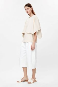 Double-layer cape top