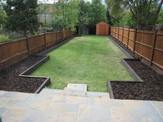 Family garden design in Barnes West London, lawn space as possible for various play activities and an intimate dining area with pleached Quercus Ilex trees