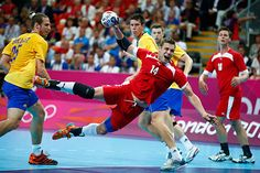 Sweden's Kim Ekdahl du Rietz (l.) watches as Denmark's Michael Knudsen shoots during their men's handball quarterfinal match at the Basketball Arena, Aug. 8. - The Christian Science Monitor - CSMonitor.com