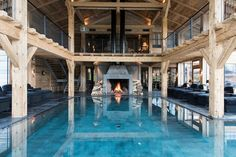 A sensational barn inspired spa with fireplace and indoor-outdoor pool