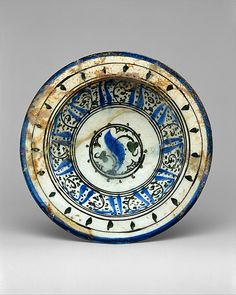 Bowl with Pseudo-inscription  Object Name:     Bowl Date:     13th century Geography:     Syria Medium:     Stonepaste; polychrome painted under a transparent glaze