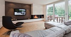 Modern corner fireplace with Bose VideoWave system and fitted wardrobes. Back wall with lime-marble spatula technique. Home Fireplace, Modern Fireplace, Living Room With Fireplace, Fireplace Design, Fireplaces, Living Room Tv, Home And Living, Muebles Living, Living Room Designs