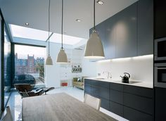 Soho Apartment is a minimalist apartment located in London, England, and designed by Dive Architects. Their proposal was to build over the. Soho Apartment, Apartment Kitchen, Dream Apartment, Apartment Ideas, Minimalist Apartment, Minimalist Interior, City Living, Living Spaces, Cavity Sliding Doors