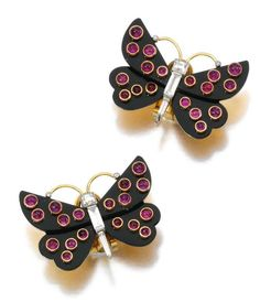 Lot 255 - PAIR OF ONYX, RUBY AND DIAMOND EAR CLIPS, CARTIER, 1940S