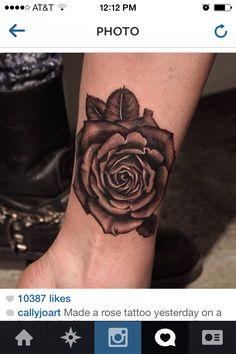 Cool black rose tattoo