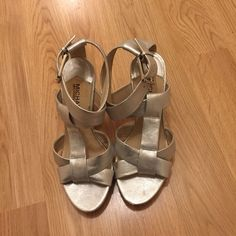Silver Michael Kors Heels Really pretty. Have been worn but show little signs of wear. Michael Kors Shoes Heels