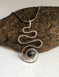 A personal favorite from my Etsy shop https://www.etsy.com/listing/476343059/silver-wire-swirl-pendant