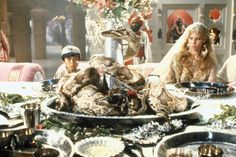 """Indiana Jones: Sarah as Indie, Me as Shortround. Chilled Monkey Brains: brain-shaped jello served in fake monkey heads. Also, """"Snake Surprise"""" shaped cake."""