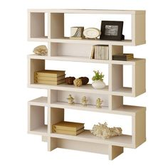 Great wall unit - you can organize and display collections in the different cubbies and it's not overwhelming because of the light wood color and all the positive space. Very nice and great accent for a mid-century interior.
