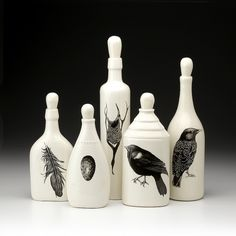 bottles painted white with designs