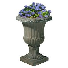 """Highlight your poolside decor with this elegant urn-shaped planter, or use a pair to flank your front walk for classic style.   Product: PlanterConstruction Material: StoneColor: Antique greenDimensions: 26"""" H x 20"""" W x 20"""" D"""
