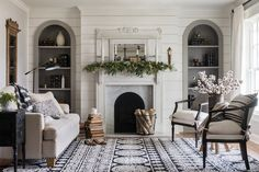 marble fireplace surround/gray arched niches/family room/living room/ship lap/living room rug/mantle