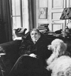 "Gertrude Stein with her poodle ""Basket."" Living in Paris."
