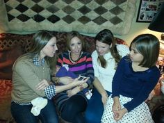 Our daughter, Erika, holding Ava, while Angie shows pics to Christina and Natalia.