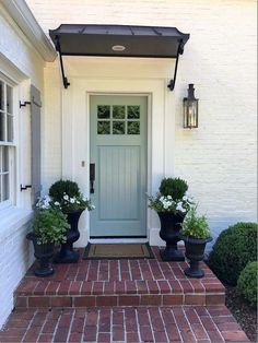 Front Door Paint Colors - Want a quick makeover? Paint your front door a different color. Here a pretty front door color ideas to improve your home's curb appeal and add more style! Front Door Awning, Front Door Planters, Front Door Entrance, Exterior Front Doors, Exterior Paint, Exterior Design, Front Entry, Urn Planters, Black Planters