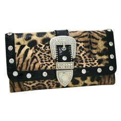 Western Rhinestone Bling Belt Buckle Wallet With Checkbook - Leopard. Made of high quality faux leather. Beautiful rhinestones & studs on the front with belt buckle accent. Black color trim. Trifold walet secured by magnetic snap. 2 transparent ID window & 12 credit card slots. 3 Wide flat compartments. Checkbook included inside. Exteriro back zippered pocket. Approx. Size. L7.5''x H4.5''x D1''.
